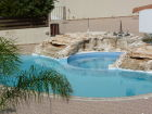 Close up of pool, and jacuzzi area. The jazuzzi is a great area to sit with toddlers as it is quite shallow